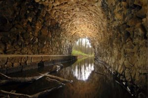 A sewer of rough medieval stonework