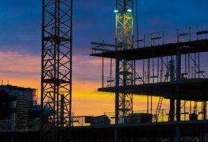 Office block construction site at dusk.